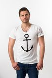 Young brunette Man with Anchor T-shirt Royalty Free Stock Photography