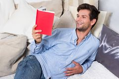 Young Brunette Man Reading A Book Stock Photo