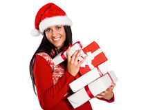 Young brunette with many christmas presents Royalty Free Stock Photography