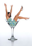 Young brunette in a martini glass Royalty Free Stock Photos