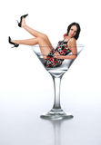 Young brunette in a martini glass Stock Images