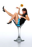 Young brunette in a martini glass Royalty Free Stock Photo