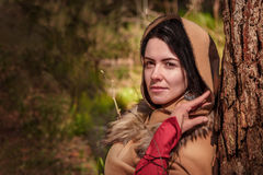 Young brunette in medieval costume in the woods. Young brunette in medieval costume in the  springwoods Royalty Free Stock Photography