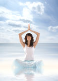 A young brunette is meditating in the waters Royalty Free Stock Image