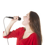 Young brunette with microphone in studio Royalty Free Stock Photo