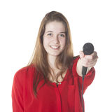 Young brunette with microphone in studio Stock Photos
