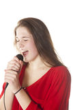 Young brunette with microphone in studio Royalty Free Stock Images