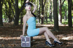 The young brunette model poses in park Stock Photo