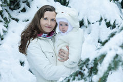 Young brunette mother with her daughter Stock Images