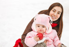 Young brunette mother with her daughter outdoors Royalty Free Stock Photos