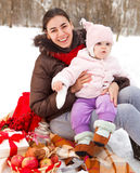 Young brunette mother with her daughter outdoors Stock Photography