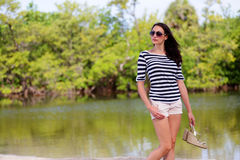 Young brunette in a nature landscape Stock Image