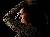 Young Brunette On Black Profile Touching Hair Royalty Free Stock Photo