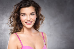 Young brunette in pink bra Royalty Free Stock Photos