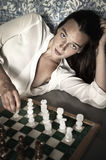 Young brunette playing chess Stock Photo