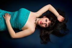 Young brunette portrait shot in studio on dark background Royalty Free Stock Image