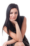 Young brunette posing in black dress Stock Photo