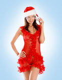 A young brunette is posing in a Christmas hat Royalty Free Stock Photo