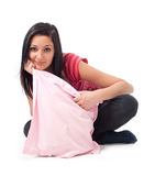 Young brunette posing with pillow Stock Photos