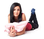Young brunette posing with pink pillow Stock Photography