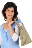 Young brunette with purse Royalty Free Stock Image
