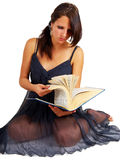 Young brunette reading a big book Royalty Free Stock Image