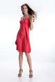Young Brunette In Red Dress Stock Photo