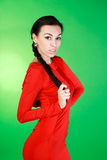 Young brunette in red dress Stock Images