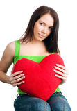 Young brunette with red heart isolated Stock Photo