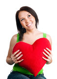 Young brunette with red heart isolated Stock Photography