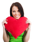 Young brunette with red heart isolated Royalty Free Stock Images