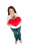 Young brunette with red heart isolated Royalty Free Stock Photo