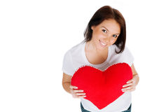 Young brunette with red heart isolated Stock Photos