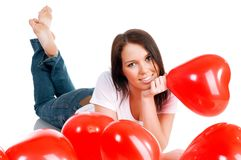 Young brunette with red hearts isolated Royalty Free Stock Image