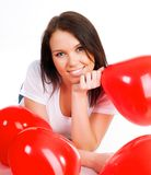 Young brunette with red hearts isolated Royalty Free Stock Images