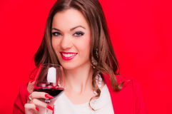 Young brunette with red wine Stock Images