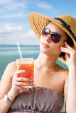 Young brunette relaxing at the beach. Royalty Free Stock Photo