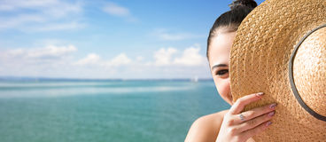 Young brunette relaxing at the beach. Stock Photo