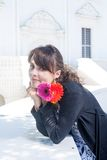 Young brunette relaxing with bunch of flowers Stock Photography