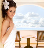 A young brunette is relaxing in a luxurious hotel Royalty Free Stock Image
