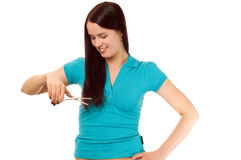 Young brunette with scissors cutting hair Royalty Free Stock Photo