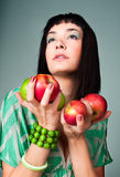 Young brunette seductive woman  holding an apple Royalty Free Stock Photo