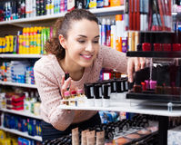 Young brunette selecting lipstick Stock Photo