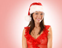 A young brunette in a sexy Christmas dress Stock Images