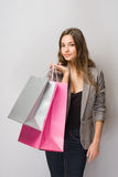 Young brunette shopper. Royalty Free Stock Image