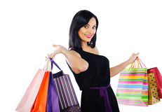 Young brunette with shopping bags Royalty Free Stock Photos