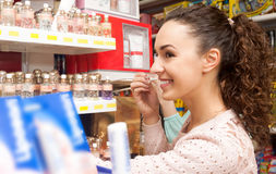 Young brunette shopping. Portrait of lovely young brunette shopping in beauty store Royalty Free Stock Photos