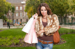 Young brunette shopping woman. Royalty Free Stock Photo