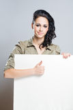 Young brunette showing thumbs up. Stock Image