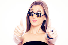 Young brunette showing thumbs up with both hands Royalty Free Stock Images